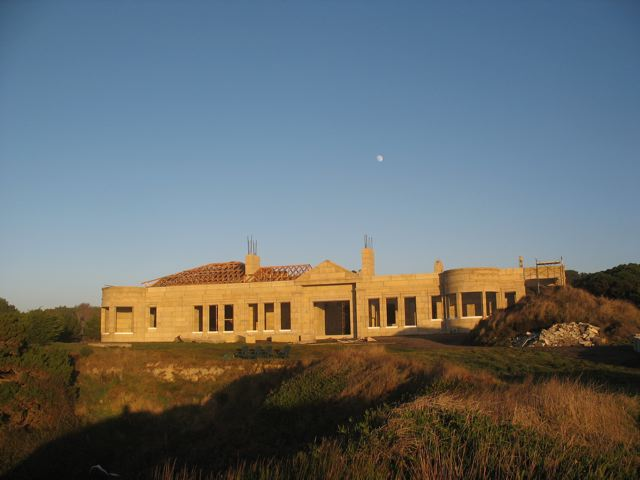 view from the coast of the Colbert DAC-ART custom coastal stone home